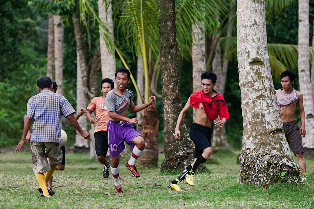 Soccer between trees near Krui, Sumatra