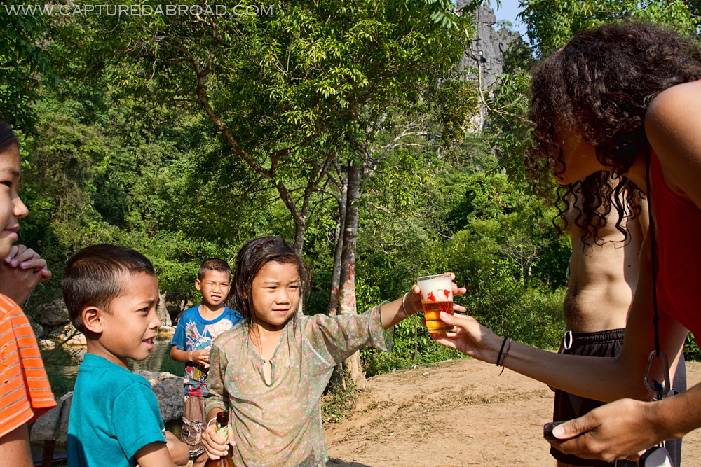 "Kid serving Beer Laos in Bo Houay Namgen on the ""Thakhek loop"""