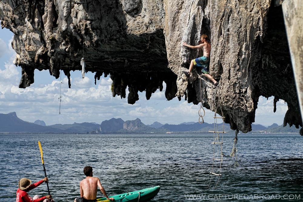 Deep water soloing on cliffs off Ton Sai beach, Krab