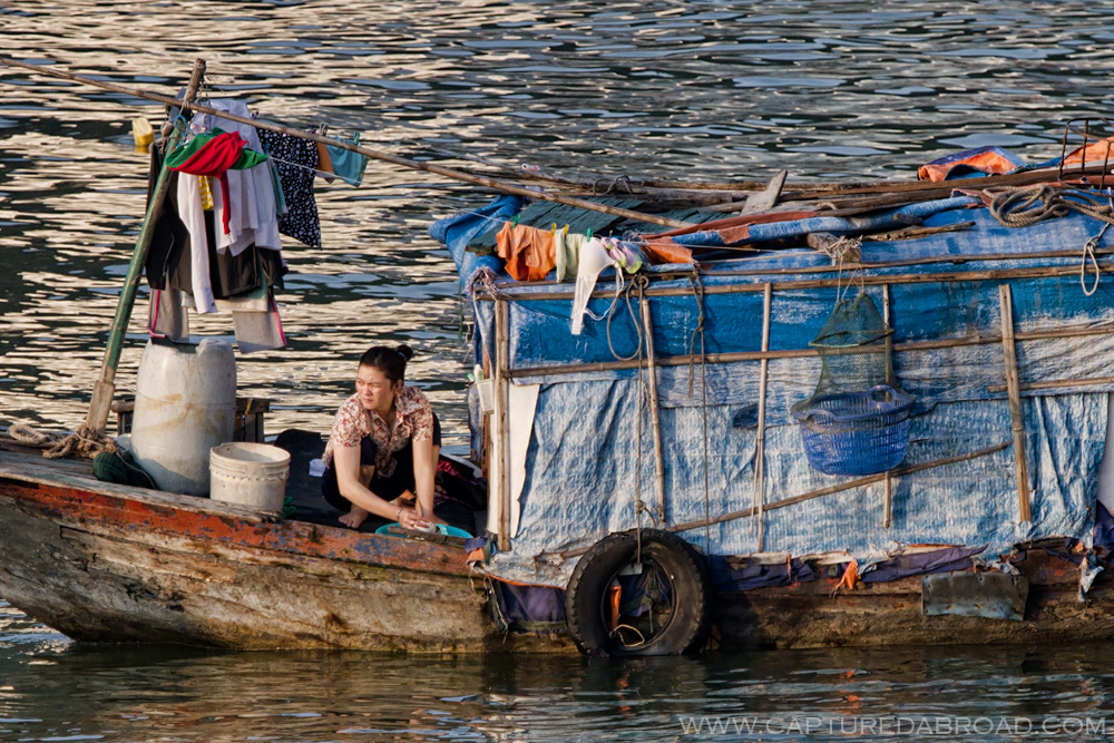 Women washing in boat, Vietnam Cat Ba