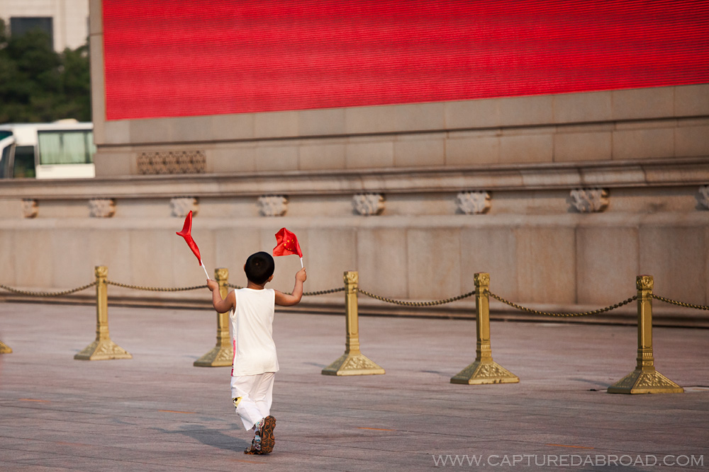 Kid waving the Chinese flag at Tiananmen square