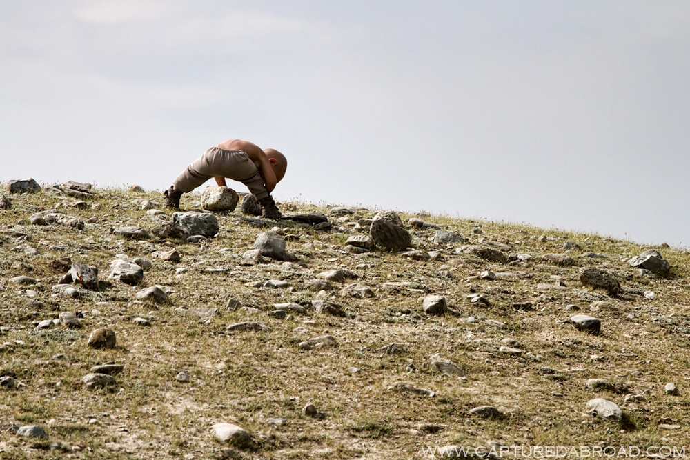 Kid playing on a hill by the Khurgan Nuur Mongolia