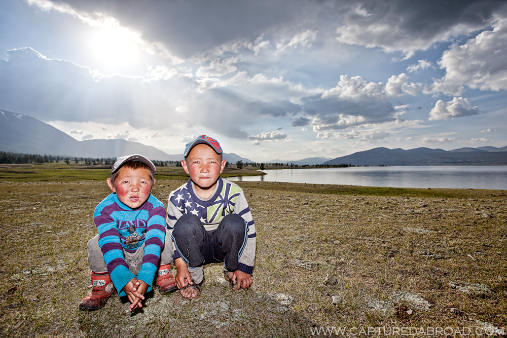Curious kids observing me eat by the Khurgan Nuur Mongolia, sunset