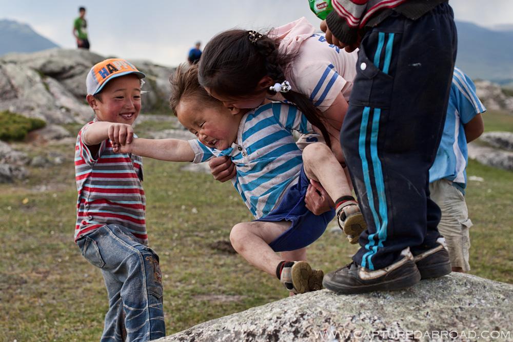 Mongol kazak kids playing at khurgan nuur mongolia