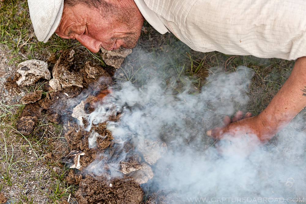 Cow dung fire, cooking fish from Khurgan Nuur, Mongolia