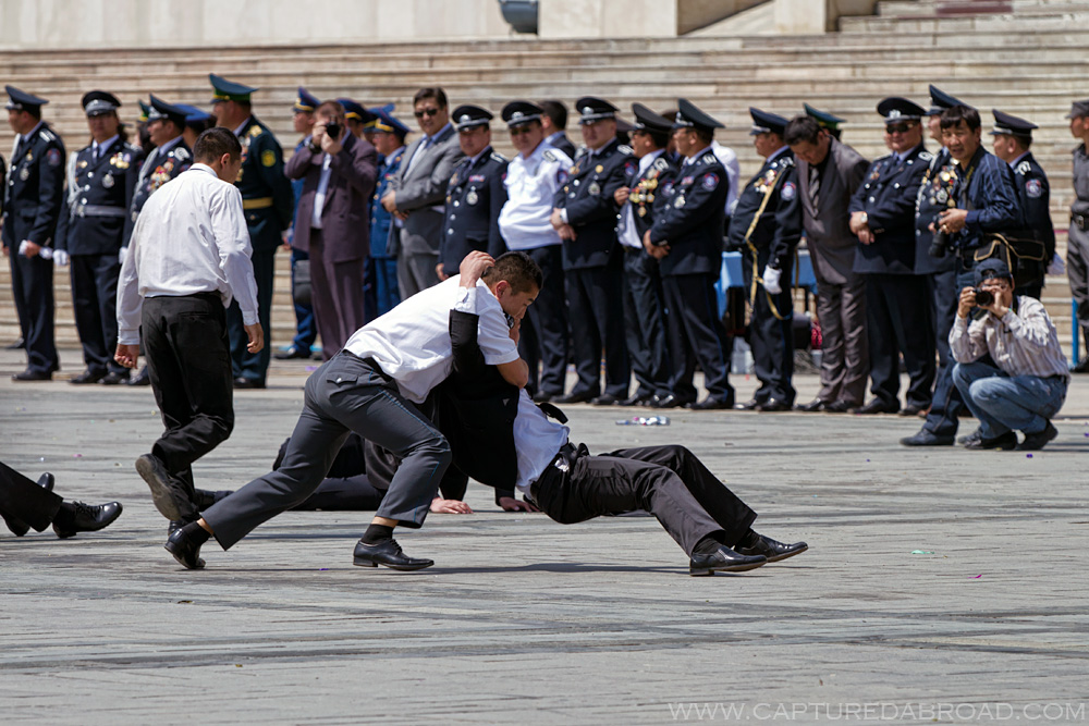 Mock fighting in Sukhbaatar square, Ulan Bator Mongolia