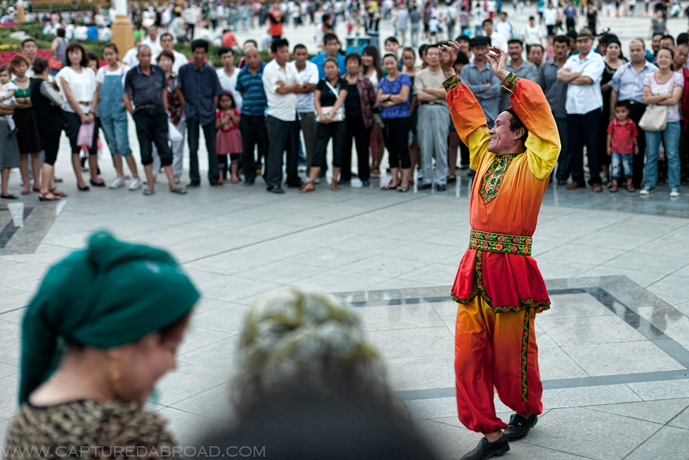 China, Xingjiang province, ethnic Uyghur man dancing in square