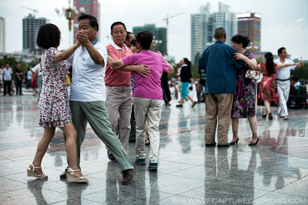 Squares in China often full of activites, Urumqi