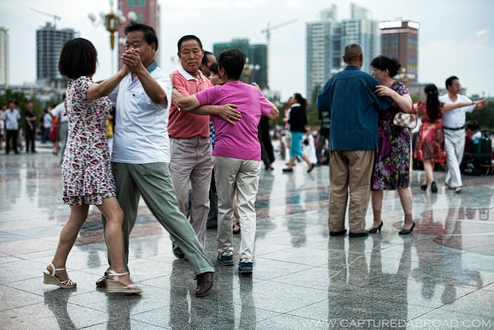 Squares in China often full of activites, Urumqi